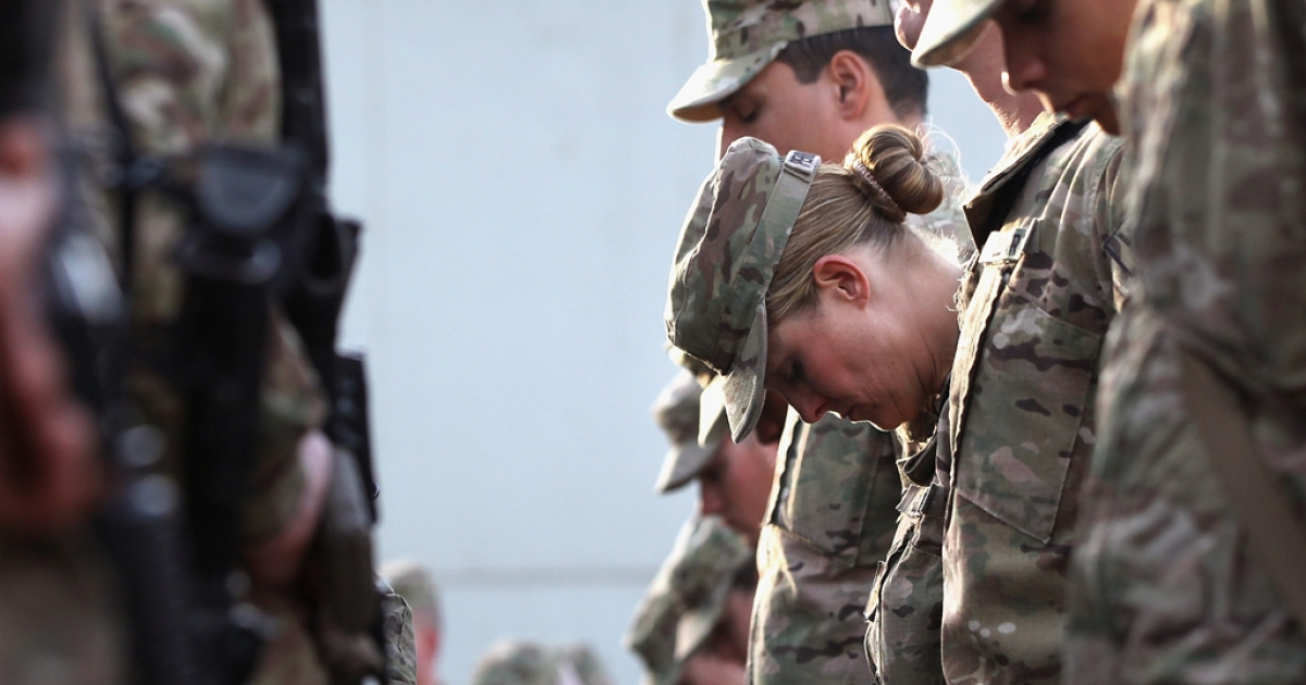 US soldiers pray during the an anniversary ceremony of the terrorist attacks on September 11, 2001 on September 11, 2011 at Bagram Air Field, Afghanistan. Ten years after the 9/11 attacks in the United States and after almost a decade war in Afghanistan, American soldiers paid their respects in a solemn observance of the tragic day.</p>