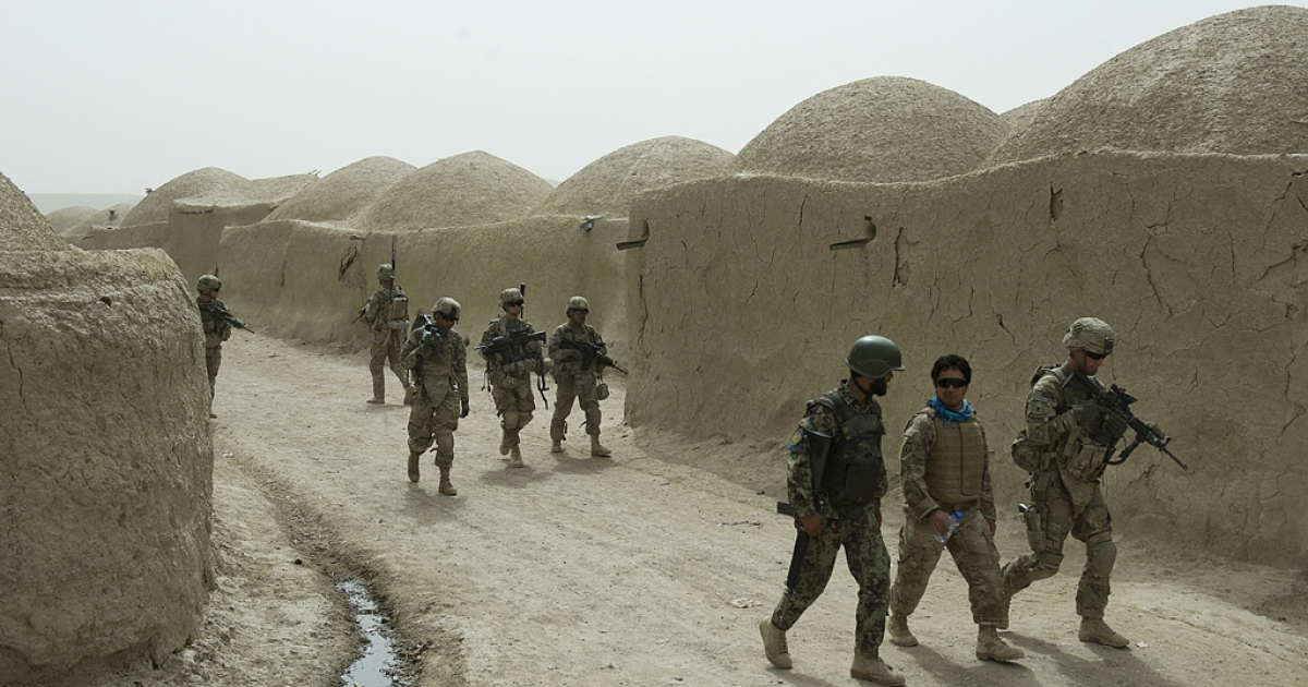 Soldiers from the Afghanistan National Army (ANA) and US Army soldiers from the 3rd platoon Delta company conduct a joint patrol  at Nevay-deh village in Kandahar province on September 5, 2012. NATO chief Anders Fogh Rasmussen shared his
