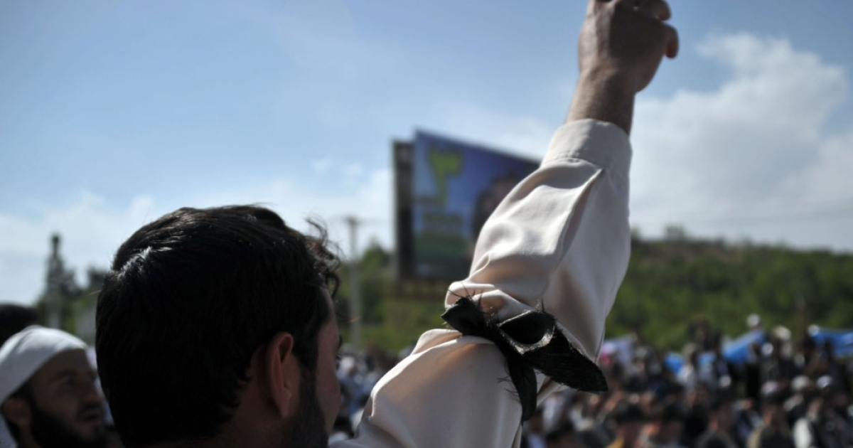 An Afghan demonstrator gestures during a protest against the US and the government of Afghanistan in Kabul on May 18, 2012. Hundreds of Afghans, most of them clerics, rallied in Kabul to protest the signing of an agreement that would allow US troops to remain in the country after the planned transfer of authority in 2014.</p>