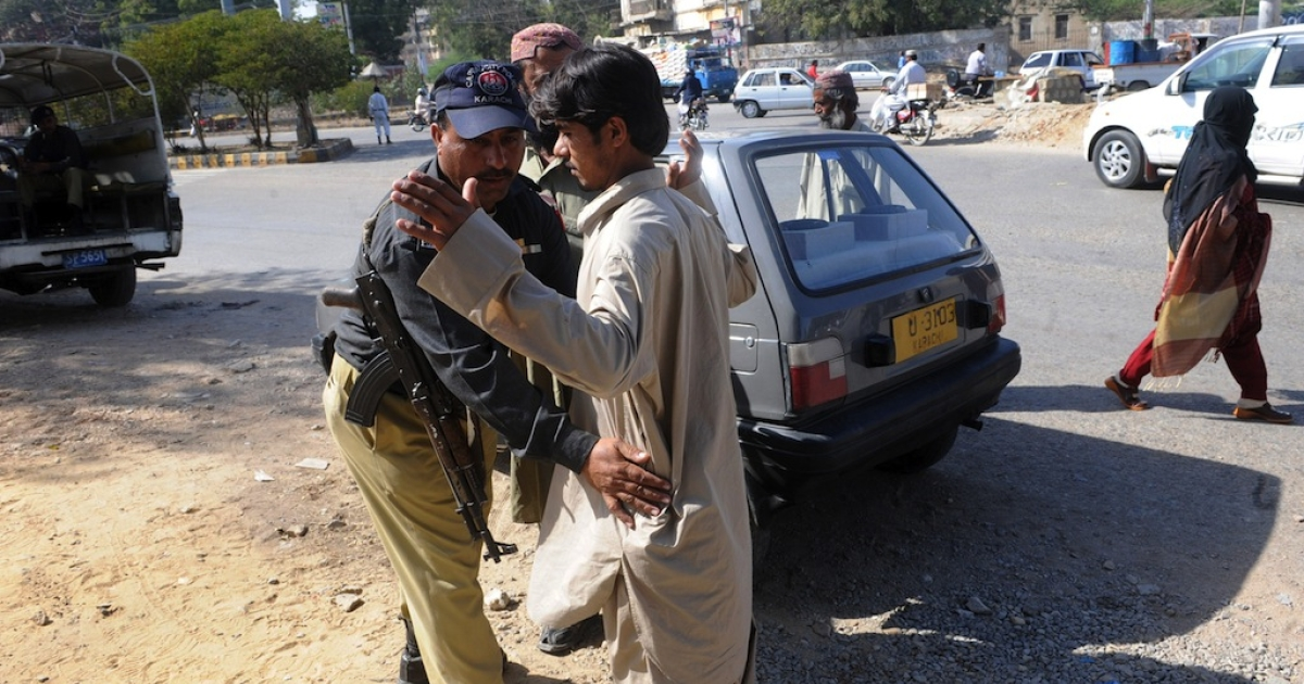 A Pakistani policeman searches a pedestrian at a security check point in Karachi on February 16, 2010. At the time, Pakistan's Interior Minister Rehman Malik branded as 'propaganda' reports that the top Taliban military commander Mullah Abdul Ghani Baradar had been arrested in a joint Pakistani-US spy operation.</p>