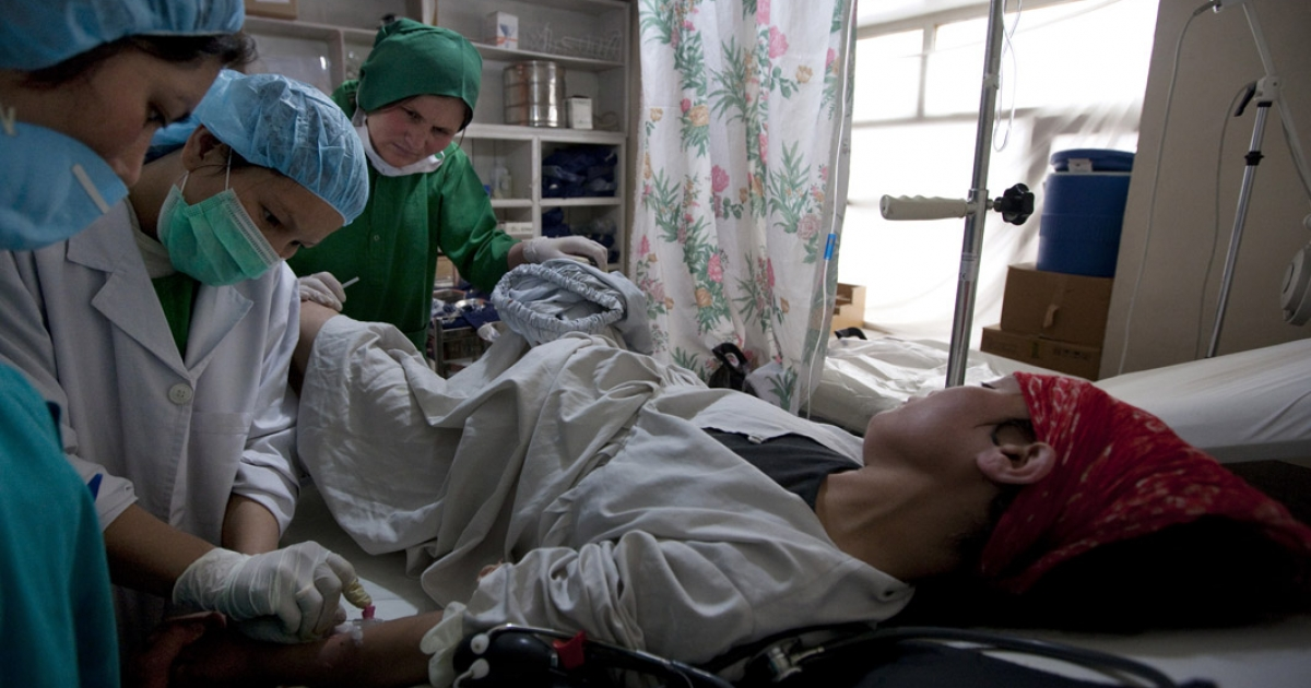 Afghan midwife students work on a pregnant woman in labor who is having complications in the delivery room at the Bamiyan Provincial hospital in Bamiyan, Afghanistan. The 18 month midwife program was funded by USAID.</p>