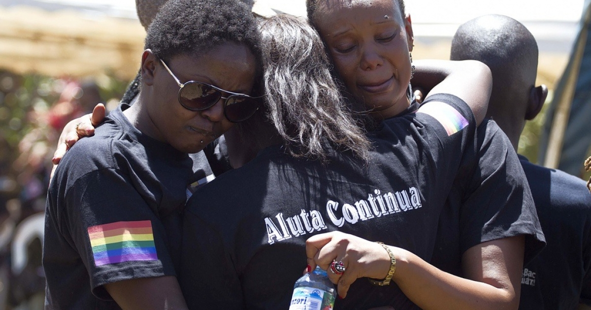 Members of the Ugandan gay community mourn at the funeral of murdered activist David Kato near Mataba, on January 28, 2011. Although the police claim it was most likely a petty crime, many members of the gay and the human rights community hold the Ugandan government responsible for not battling the growing violence against homosexuals in the Ugandan society.</p>