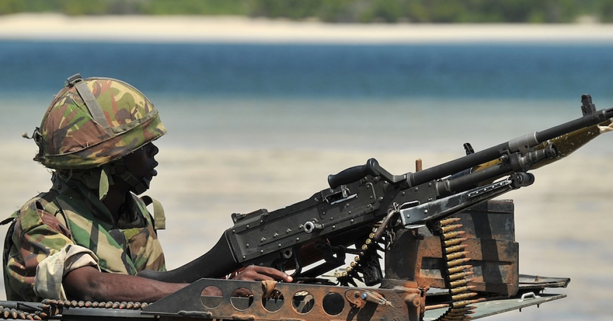 Kenyan soldiers are engaged in an ongoing war with Somalia's Al Shabaab. Here, a Kenyan Defence Force soldier keeps lookout on the coast near Burgabo village, Southern Somalia on December 14, 2011.</p>