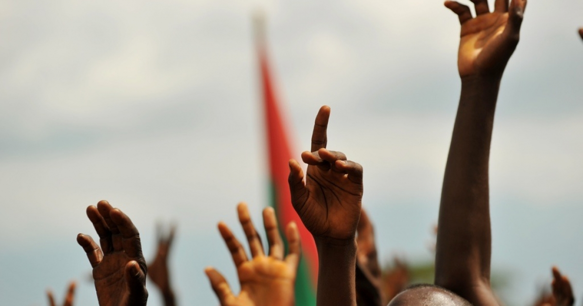 Supporters of Burundian President Pierre Nkurunziza raise their hands during a political rally in the town of Rugombo in northern Burundi on May 14, 2010. Does Nkurunziza really enjoy popularity with 89 percent of Burundi's people, or are they just too afraid to say?</p>