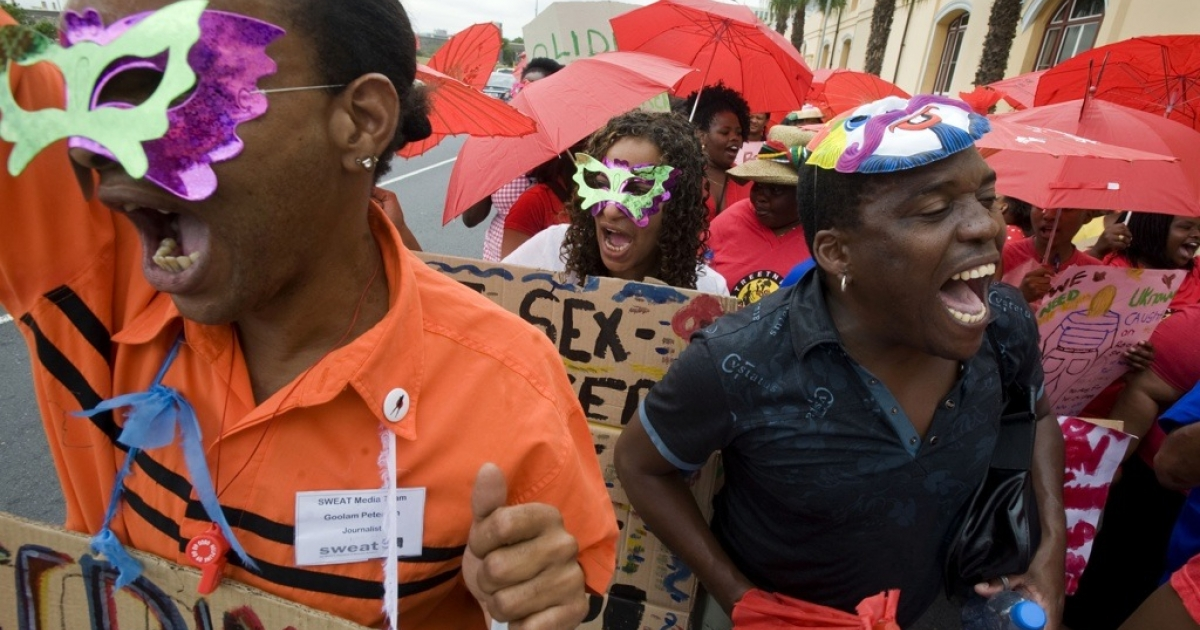 About 100 sex workers, some wearing masks to avoid identification, and human rights activists, march through Cape Town on International Sex Workers' Rights Day on March 3, 2011. Thousands of people worldwide took to the streets to march for the cause including in seven African countries: Botswana, Kenya, Mozambique, Nigeria, South Africa, Uganda and Zimbabwe.</p>