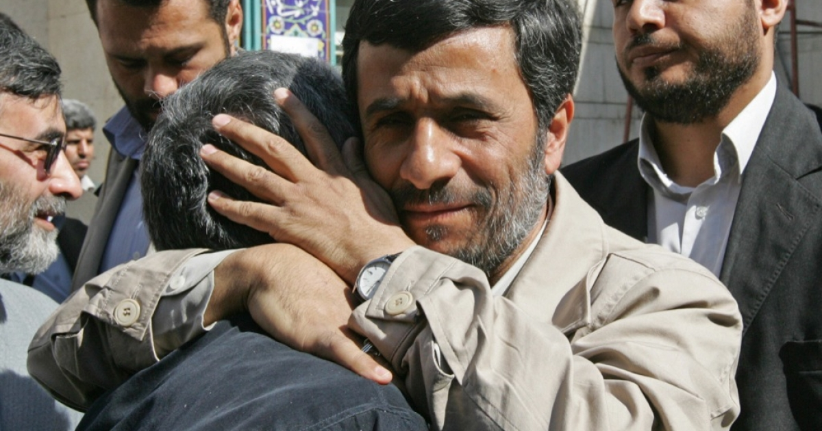Iranian President Mahmoud Ahmadinejad hugs a supporter upon arriving to cast his ballot inside a polling station in Tehran during the second round of parliamentary elections on April 25, 2008. Iranians started voting today in the second round of legislative elections expected to tighten the conservatives' grip on parliament after reformists were hurt by pre-poll disqualifications.</p>
