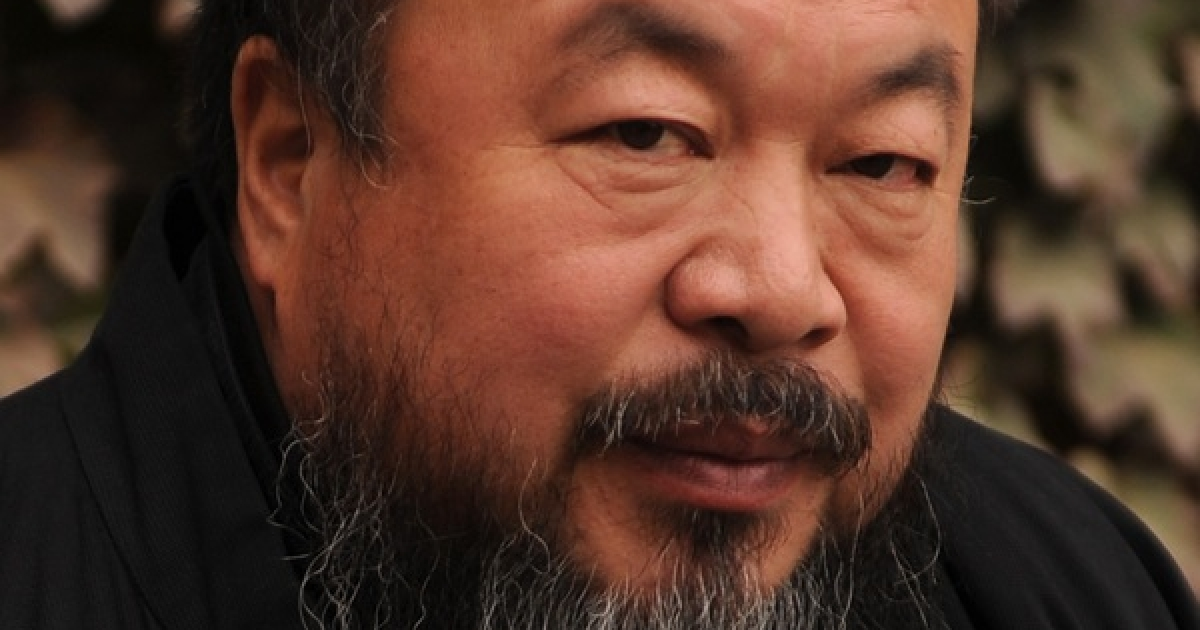 Chinese artist Ai Weiwei sits in the courtyard of his home in Beijing on November 7, 2010.</p>