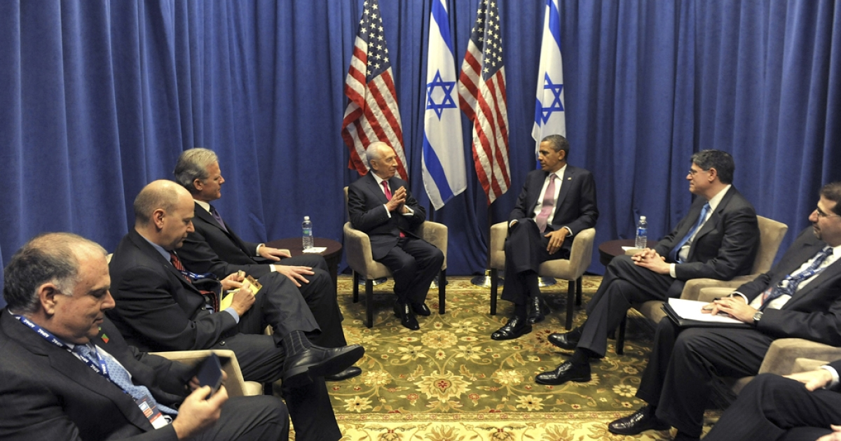 In this handout photo from the Israeli Government Press Office (GPO), Israeli President Shimon Peres (4L) meets with U.S. President Barack Obama March 4, 2012 in Washington, DC. On the heels of his AIPAC address, Obama met with Israel's Prime Minister Benjamin Netanyahu at the White House Monday on March 5, 2012 to discuss Iran and other issues.</p>