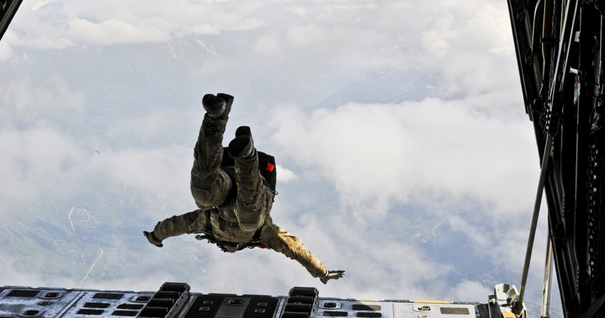 An Alaska Air National Guard pararescueman performs a high-altitude jump from a Coast Guard C-130 Hercules during a training mission above Joint Base Elmendorf-Richardson on June 23, 2011.</p>