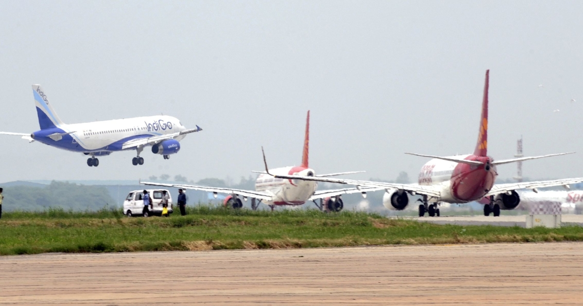 Aircraft from Indigo (L), Air India (C) and Spicejet (R) jostle for space on a runway at Indira Gandhi International Airport in New Delhi on July 13, 2011.</p>