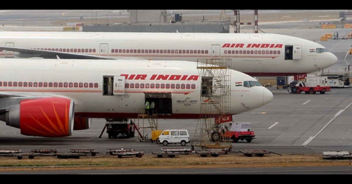Air India aircrafts are seen parked on the tarmac of the international airport in Mumbai on April 29, 2011. Air India on April 28 sought a court order against striking pilots as a stoppage over pay entered a second day, grounding dozens of flights and causing widespread disruption for passengers.</p>