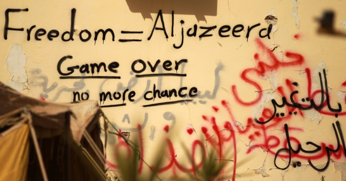 Graffiti praising Al-Jazeera news channel is seen on a wall in the eastern dissident-held Libyan city of Tobruk on Feb 24, 2011.</p>