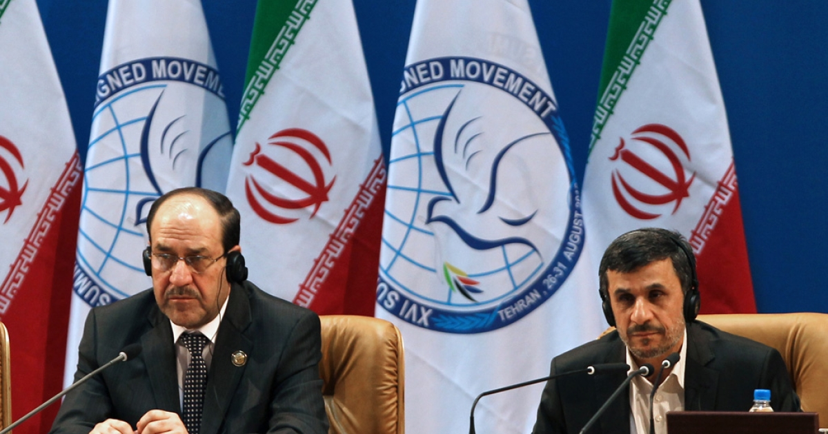 Iranian President Mahmoud Ahmadinejad, right, and Iraqi Prime Minister Nuri al-Maliki listen during the Non-Aligned Movement summit in Tehran on August 30, 2012.</p>
