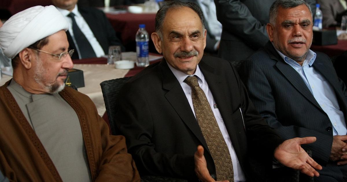 Deputy Prime Minister Saleh al-Mutlaq (center), with Iraqi deputy Khaled al-Attiyah (L) and Transportation Minister Hadi al-Amiri (R), at a press conference in Baghdad on July 6, 2011.</p>