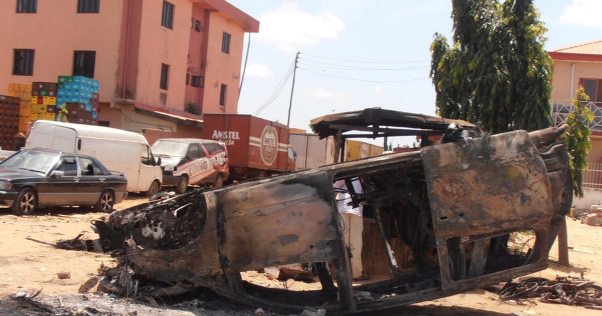A car lies upside-down, vandalized on June 17 by Christian mobs in reprisal for a suicide bomb attack. Nigeria's Boko Haram Islamists claimed responsibility for suicide attacks on three churches that sparked reprisals by Christian mobs who rampaged and burned mosques, killing least 52 people.</p>