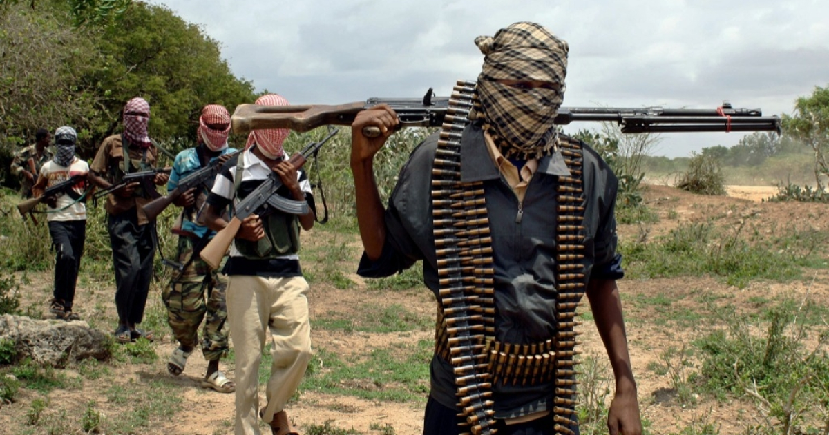 Somali hardline islamists walk past at a training camp on the outskirts of Afgoye district in Somalia's lower Shabelle region October 20, 2009.</p>