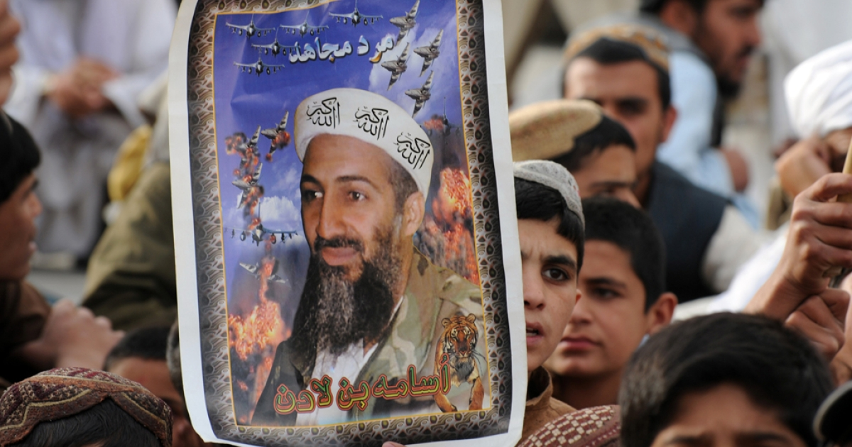 Supporters of hard line pro-Taliban party Jamiat Ulema-i-Islam-Nazaryati (JUI-N) carry portraits of the slain Al-Qaeda leader Osama bin Laden as they gather during an anti-US rally in Quetta on May 2, 2012 on the first anniversary of the death of Osama bin Laden.</p>