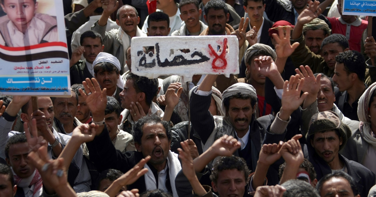 Anti-government protesters shout slogans as one holds up a sign in Arabic that reads, 'No immunity' during a rally to demand the trial for Yemen's outgoing President Ali Abdullah Saleh in Sanaa, on January 16, 2012. Al-Qaeda militants swept into the Yemen town of Rada, 80 miles southeast of the capital, overnight and overran it within hours, marking a significant advance by the extremists towards the capital Sanaa, officials said on.</p>