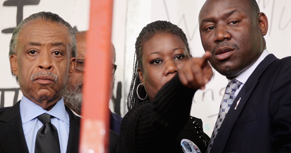 Rev. Al Sharpton (L) attends a rally with Sybrina Fulton (C), mother of slain teenager Trayvon Martin, as family attorney Benjamin Crump (R) looks on March 22, 2012 in Sanford, Florida. Sanford Police Department Chief Bill Lee announced he will temporarily step down following the killing of the black unarmed teenager by a white and Hispanic neighborhood watch captain. Sharpton organized the rally.</p>