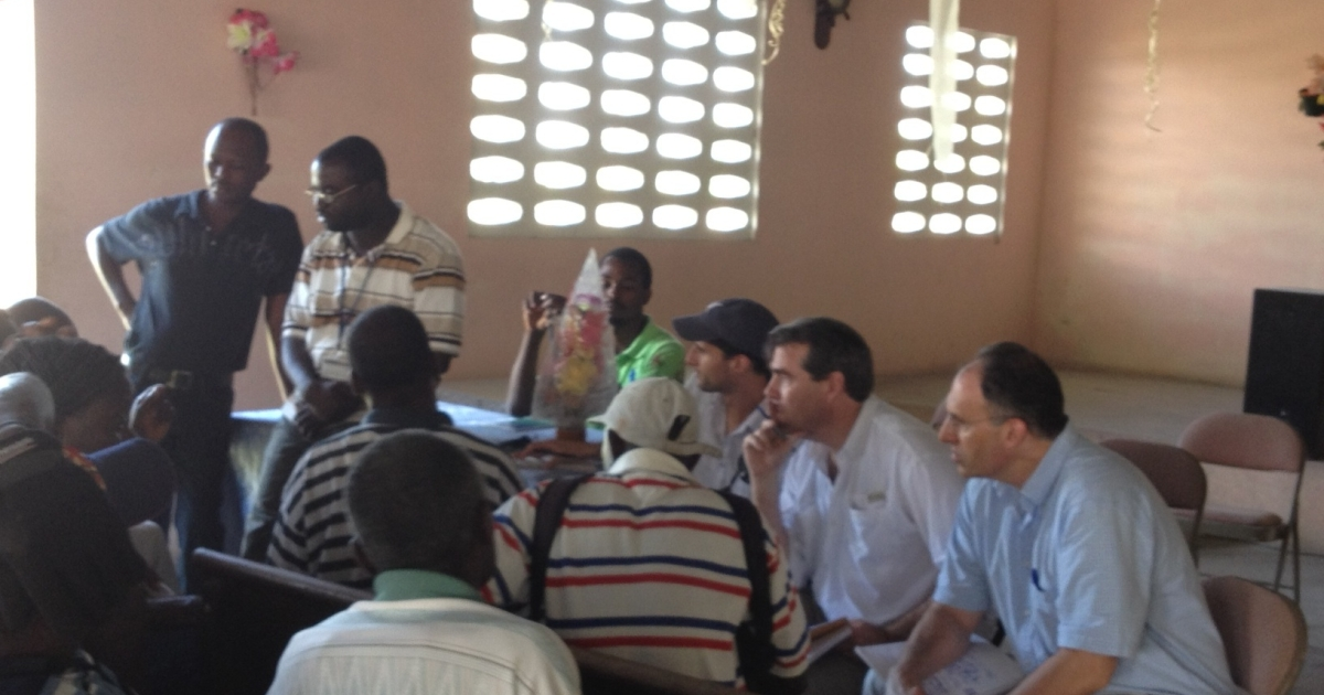 Alan Khazei, Jacob Kushner and I listen to Haitians talking about American aid in Coupon, Haiti.</p>