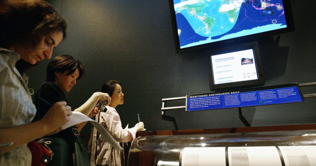 Reporters take notes at the new earthquake monitoring station June 23, 2004 at the Museum of Natural History in New York City. On exhibit in the Gottesman Hall of the Planet Earth, the earthquake station features a three-drum seismograph that constantly monitors and records the shaking of the ground as it is happening in Fairbanks, Alaska, Tuscon, Arizona and Nagano, Japan. The exhibit also features a color screen on which a map of the world alternates show real-time seismic activity.</p>