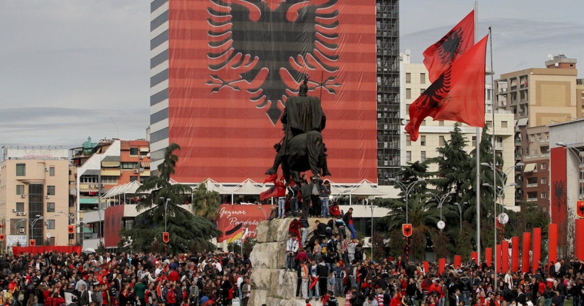 Albanians on Tirana's main square mark the 100th anniversary of independence from the Ottoman Empire last year.</p>