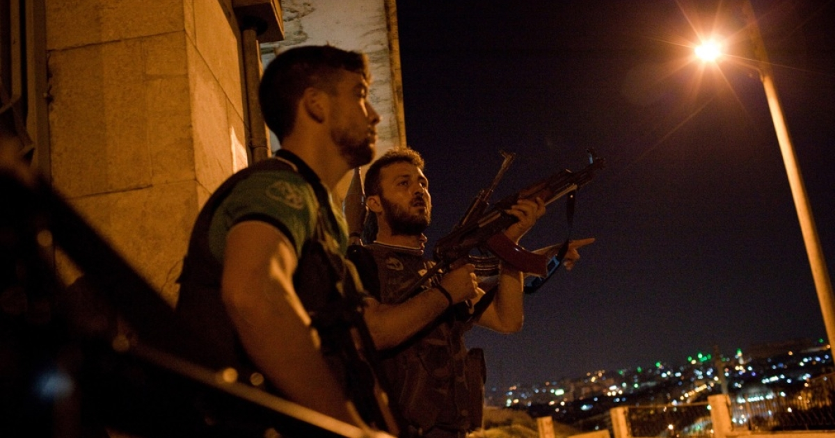 Fighters with the Free Syrian Army prepare to fight in the neighborhood of Ezza in Aleppo, Syria, on Friday, August 3, 2012, the first time the opposition army has entered the area to face government forces, facing snipers, helicopter and tank fire.</p>
