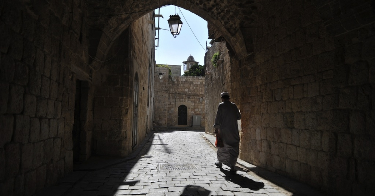 A Syrian man walks near the Umayyad Mosque in the old city of Aleppo in northern Syria on October 15, 2012. Fighting between regime forces and rebels has raged in Syria's commercial capital since mid-July, including in its UNESCO-listed old city which embraces the ancient citadel and historic covered market, or souk, as well as the landmark Umayyad Mosque.</p>