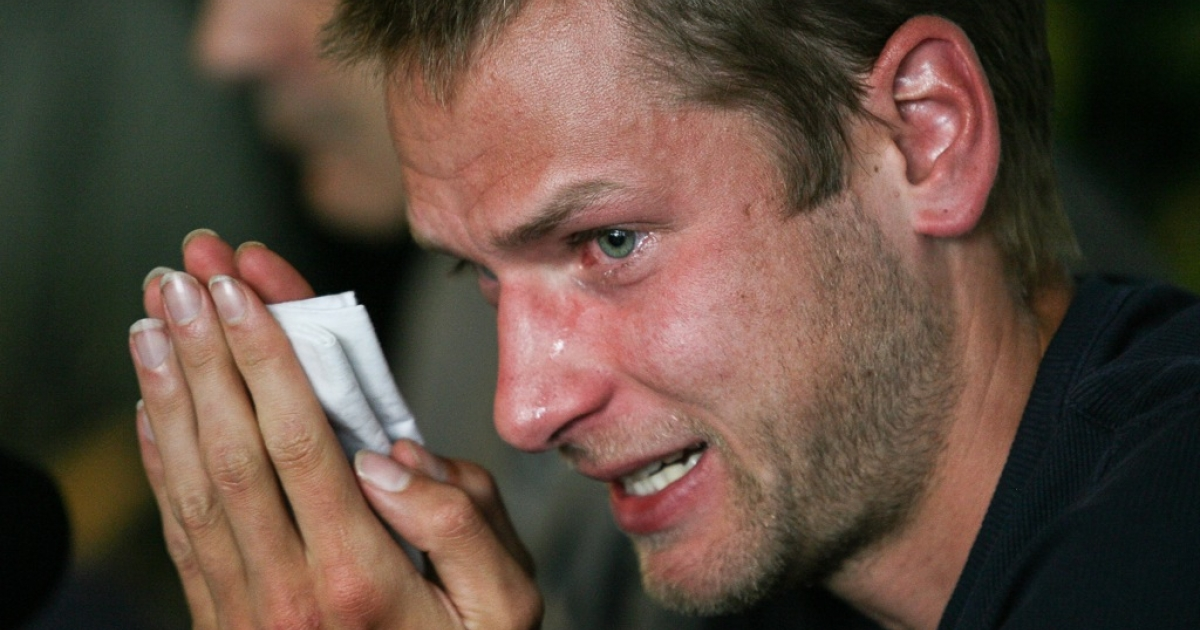Italy's Alex Schwazer, gold medalist of the men's 50 km walk at the 2008 Beijing Olympic Games, reacts as he answers journalist's questions on August 8, 2012 in Bolzano during his press conference after he failed a doping test for using the blood-boosting agent erythropoietin EPO and being banned from Italy's 2012 London Olympics delegation.</p>