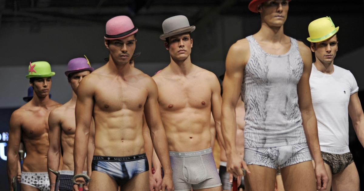 Models showcase Alexander McQueen underwear during a 2011 men's fashion week event in Singapore.</p>
