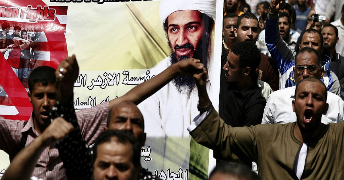 Egyptian Islamists, carrying a picture of slain Al-Qaeda chief Osama bin Laden, march to the US embassy after the weekly Friday prayers in Cairo on May 6, 2011 during a demonstration to denounce the killing of bin Laden by US forces in Pakistan.</p>