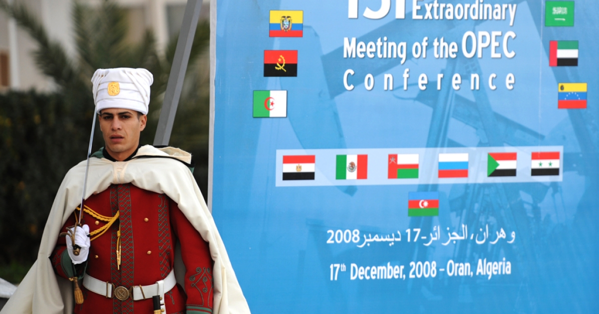 An Algerian presidential guard stands on duty near a poster for The Organization of Petroleum Exporting Countries (OPEC) on December 16, 2008. Radical Islamists in Algeria reportedly seized foreign hostages from a BP facility near the town of In Amenas on January 16, 2013.</p>