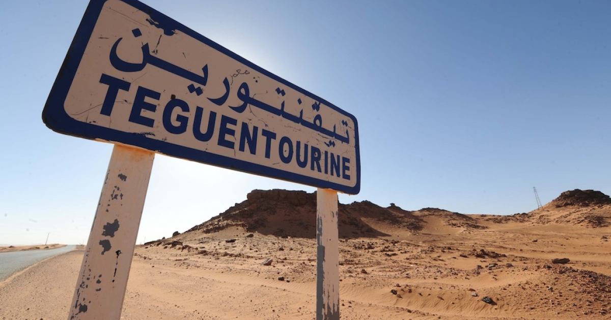 A picture shows a road sign indicating Tiguentourine near In Amenas on a road leading to a gas complex where Islamist gunmen had taken hostages in the desert in Algeria's deep south on January 19, 2013. Islamist gunmen killed seven foreign hostages in Algeria before being gunned down by special forces in a final assault on a remote desert gas complex, state television said, though five members have reportedly been found alive.</p>