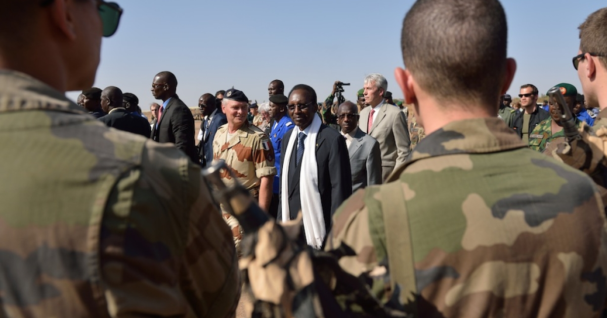 Malian President Dioncounda Traore (L) and French ambassador in Mali Christian Royer (C) arrive to visit troops at the 101 airbase near Bamako on January 16, 2013. French troops engaged in close combat with Islamist fighters in Mali today as Al Qaeda-linked fighters claimed to have seized 41 foreign hostages at a gas plant over the border in Algeria.</p>