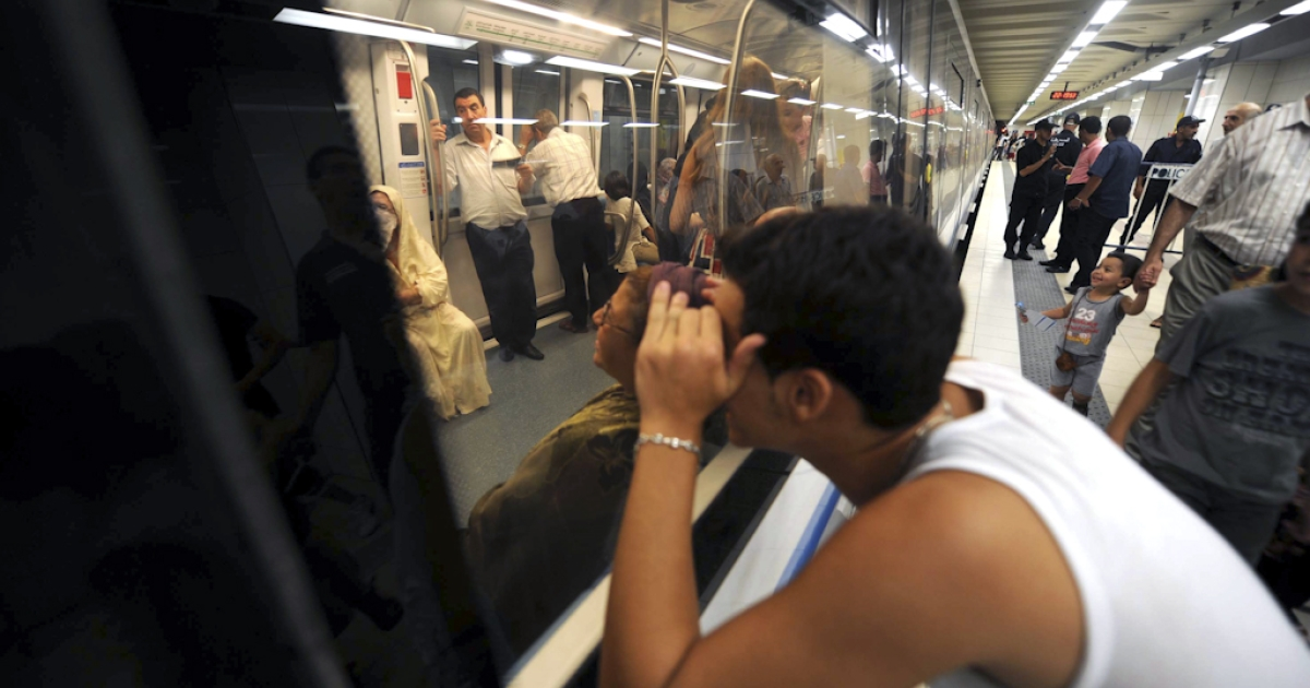 Would be passengers enter a metro carriage in La Grande Poste station in Algiers' new underground network on August 18, 2011 during an informative evening orgainised by the the transport authorities to familiarise commuters with the new line.</p>