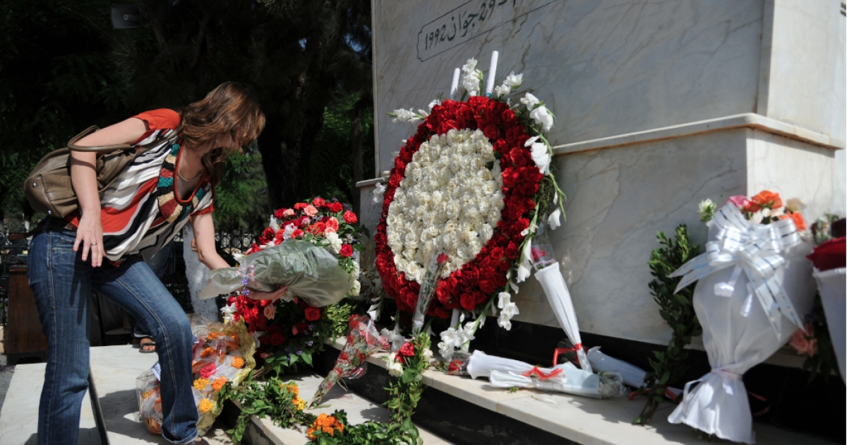 People lay floral tributes at the memorial to late Algerian president Mohamed Boudiaf a week before the country marked 50 years of independence from France on July 5, 2012. Boudiaf was assassinated on June 29, 1992, after only six months as president.</p>