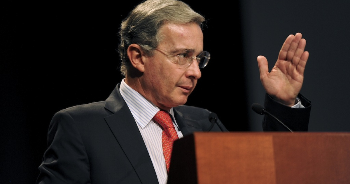 Colombia's former President Alvaro Uribe delivers a speech at the international seminar, 'Latin America: Opportunities and Challenges' in Lima on March 20, 2012.</p>
