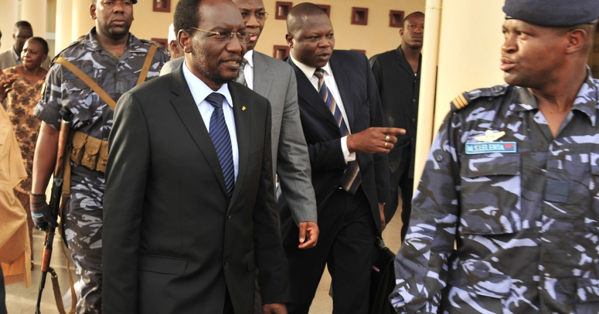 Malian Parliament Speaker Dioncounda Traore, followed by Burkina Faso Foreign Minister Djibril Bassole on April 7, 2012 upon his arrival at the Bamako airport from Burkina Faso. Malian President Amadou Toumani Toure officially resigned on April 8, 2012.</p>