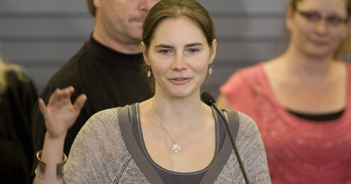 Amanda Knox waves to supporters as she makes her first appearance at SeaTac Airport after arriving in Seattle following her release from prison in Italy on October 4, 2011. She told CBS in a letter that she was sexually harassed in prison.</p>