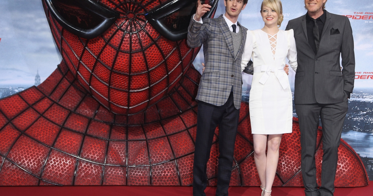 Andrew Garfield, left, Emma Stone and Rhys Ilfans attend the German premiere of