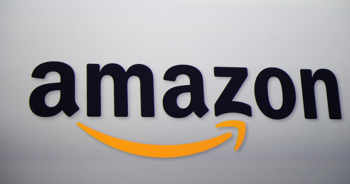 The Amazon logo is projected on a screen at a press conference in New York on Sept. 28, 2011.</p>