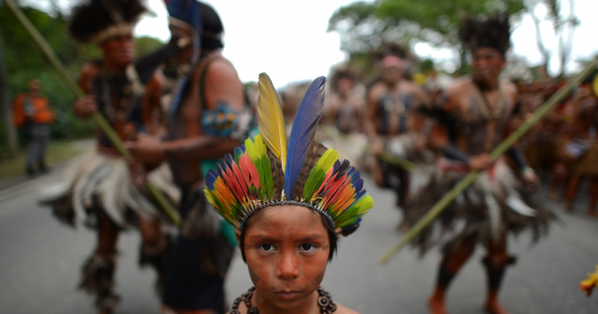Amazon.com shouldn't mess with its namesake jungle, say Peru and Brazil, home to indigenous peoples such as this group at the Rio+20 sustainable development summit in Rio de Janeiro, Brazil in June.</p>