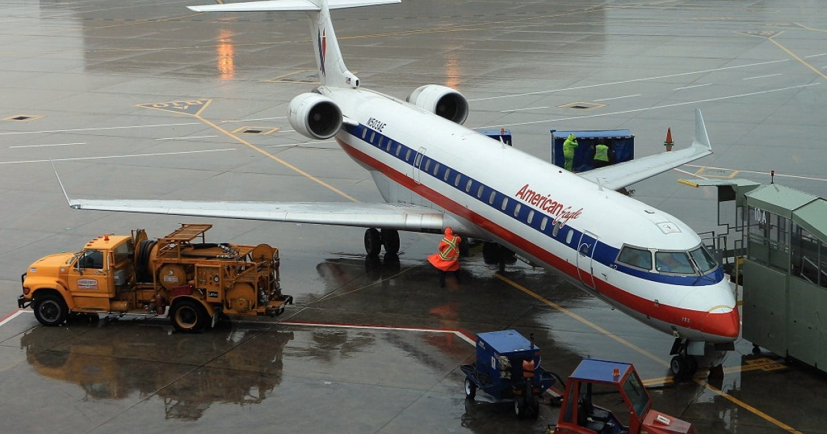 An American Airlines plane at the airport.</p>