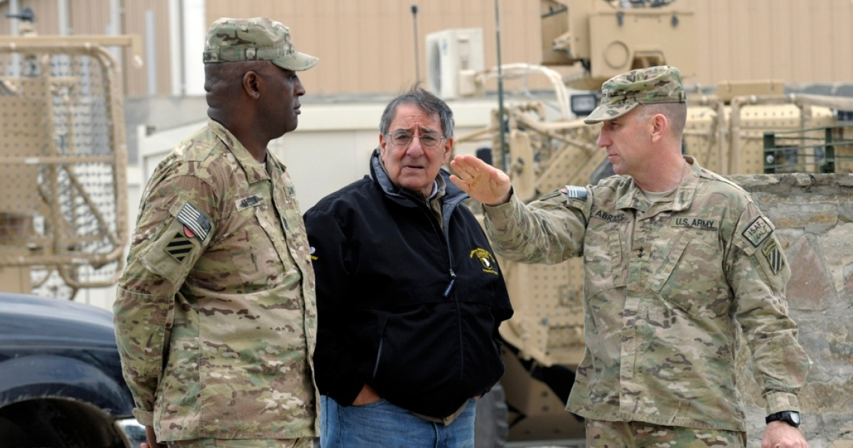 US Defense Secretary Leon Panetta talks with Army Maj. Gen. Robert Abrams, (R) and Command Sgt. Maj. Edd Watson, (L) during a visit to Kandahar Airfield on December 13, 2013 Kandahar, Afghanistan. Secretary Panetta is meeting with Afghan president Hamid Karzai and top Afghan officials as the the U.S. look towards a decision on troop numbers once the U.S. led coalition ends in late 2014.</p>