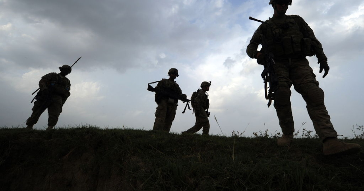 US soldiers from Viper Company (Bravo), 1-26 Infantry walk during a patrol at Combat Outpost (COP) Sabari in Khost province in the east of Afghanistan on June 22, 2011.</p>