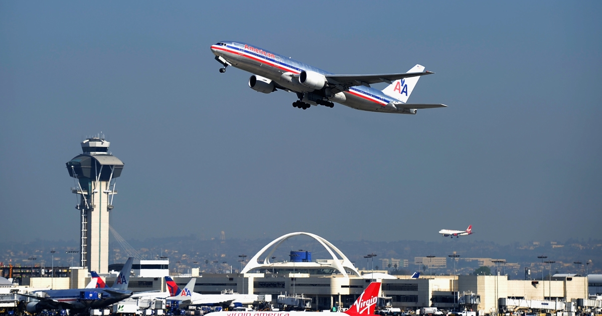 An American Airlines passenger plane takes off from Los Angeles International Airport on Feb. 1, 2012.</p>