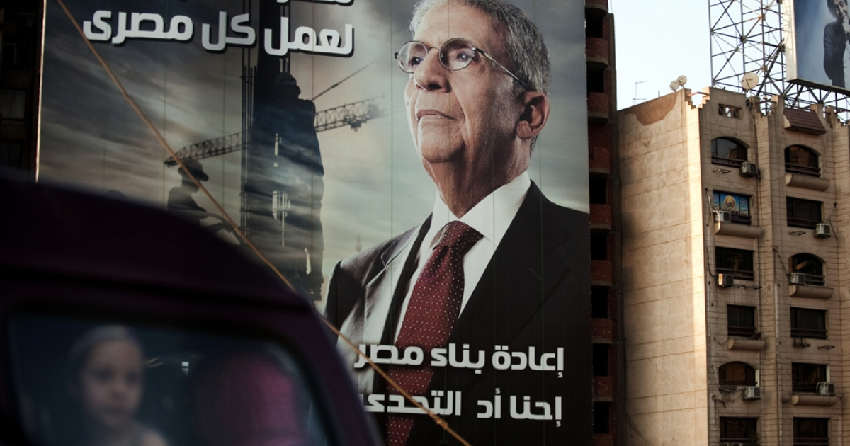 A vehicle drives past a billboard in Cairo advertising former Arab League General Secretary and presidential candidate Amr Mussa on May 8, 2012.</p>