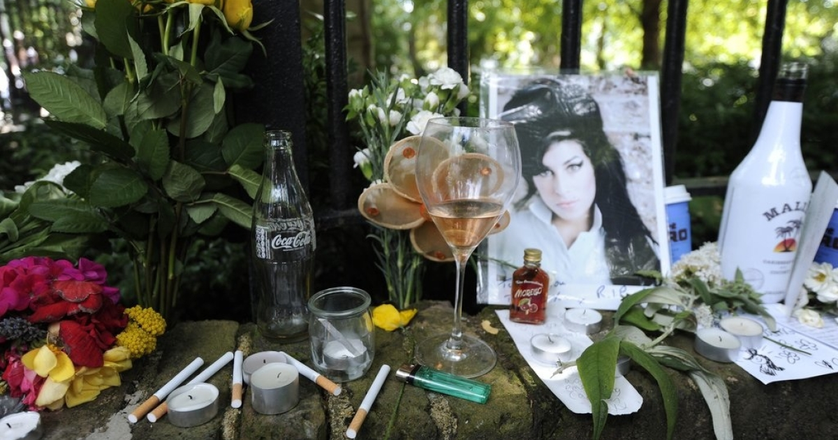 Fans leave behind flowers and messages as well as cigarettes and alcohol to remember the pop star Amy Winehouse, who struggled with drink and drugs, and was found dead at her flat in North London on July 23, 2011.</p>