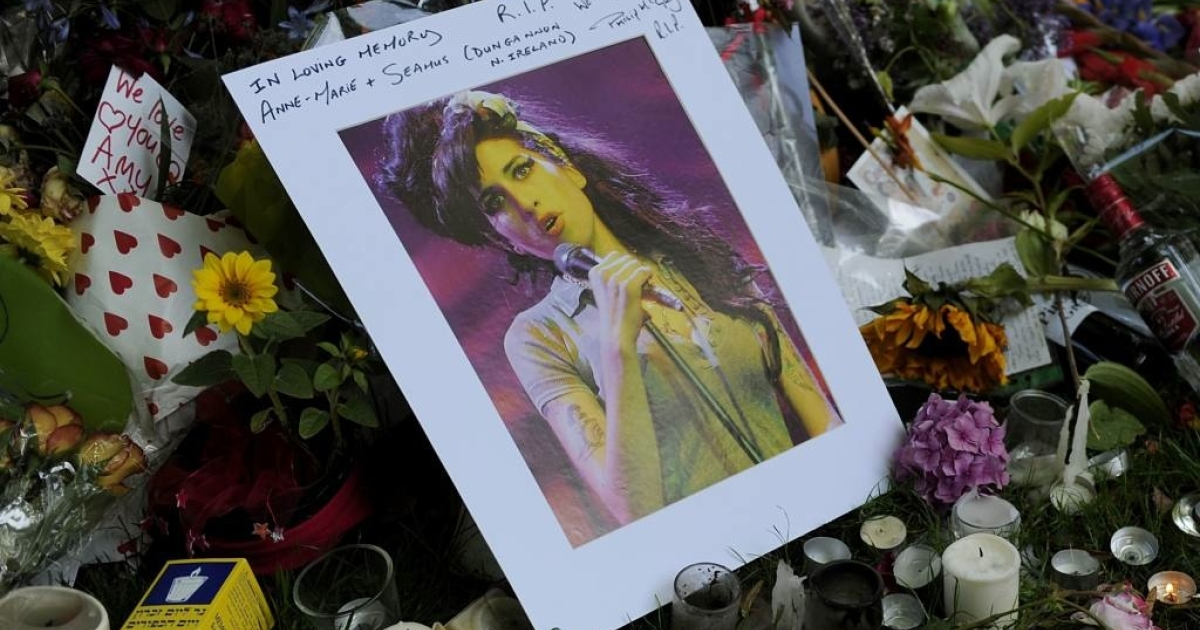 Fans bought the late Amy Winehouse's CDs and set up a large memorial near her Camden Square home in London where her body was found on July 23, 2011.</p>