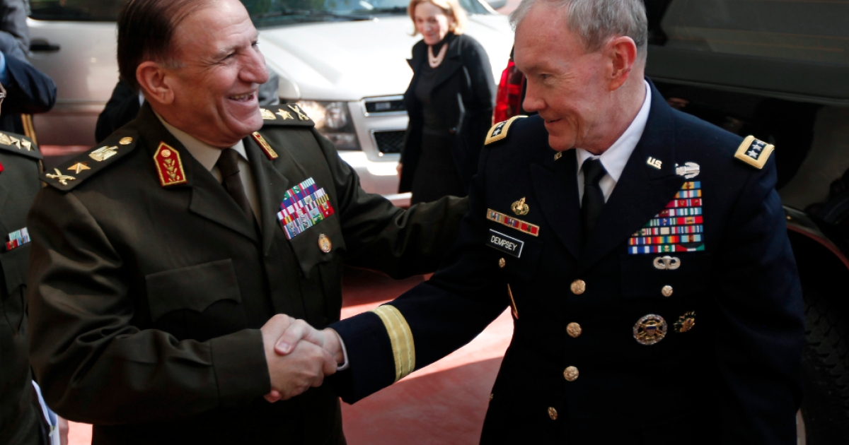 Egyptian Lieutenant General Sami Anan (L) greets US General Martin Dempsey, chairman of the Joint Chiefs of Staff, upon the latter's arrival for a meeting at the ministry of defence in Cairo on February 11, 2012.</p>